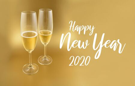 Happy New Year 2017 images. Glass with champagne on a golden background. Festive golden background. New Year toast. Two glasses of champagne stock images. Happy New Year 2017 Sign Фото со стока - 132487759