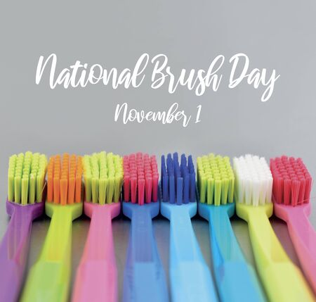 National Brush Day images. Colorful toothbrushes stock images. Morning hygiene. Bathroom accessories images. Toothbrush on silver background. Brush Day Poster, November 1 Фото со стока - 133042924