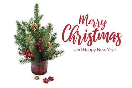 Merry Christmas and Happy New Year Sign. Christmas Spruce Twig stock images. Simple Christmas decoration. Christmas spruce branches. Decorated Christmas branches Фото со стока - 134170451