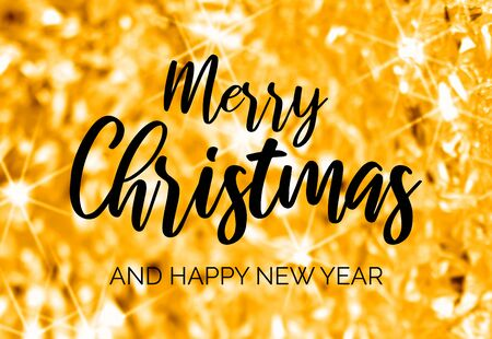 Merry Christmas and Happy New Year. Golden Christmas greeting card. Gold starry Christmas background. Glossy festive yellow background. Gold black elegant card Фото со стока - 134170510