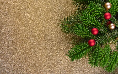 Christmas tree decoration stock photography Christmas tree branch. Beautiful Christmas background. Xmas decorations on gold background Stock Photo
