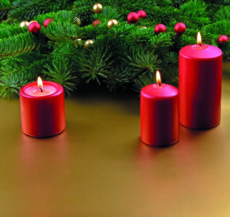 Red candles on christmas background stock images. Christmas ornament. Red Christmas candles on a golden background. Christmas background with copy space for text