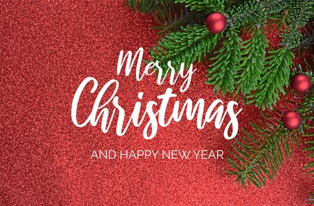 Merry Christmas and Happy New Year Sign. Christmas red background with ornate spruce branch stock images. Elegant holiday background. Christmas greeting card Фото со стока - 135086728
