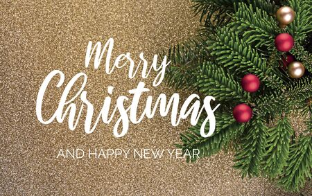 Merry Christmas and Happy New Year Sign. Christmas Golden Shiny Background with Ornate Spruce Branch stock images. Elegant holiday background. Golden Christmas greeting card