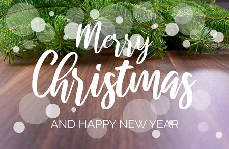 Merry Christmas and Happy New Year Sign. Christmas background with ornate spruce branch. Elegant holiday background. Christmas greeting card Фото со стока - 135099675