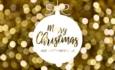 Merry Christmas and Happy New Year. Glossy yellow background. Abstract golden background. Gold blurred bokeh wallpaper. Festive blur backdrop. Christmas greeting card. White Christmas ball