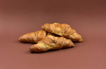 Butter croissant stock images. Croissant isolated on white background. Sweet pastry images Фото со стока