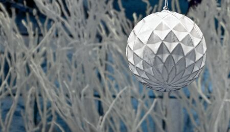 White Christmas Ball stock images. White Christmas background with copy space for text. Festive light background. Xmas decorations ball