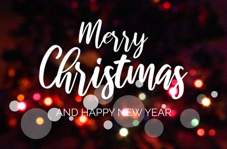 Merry Christmas and Happy New Year sign with blur effect. Colorful blurred bokeh wallpaper. Festive blur backdrop. Christmas greeting card. Christmas background