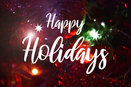 Happy Holidays sign with blur effect. Colorful blurred bokeh wallpaper. Festive blur backdrop. Christmas greeting card. Christmas background