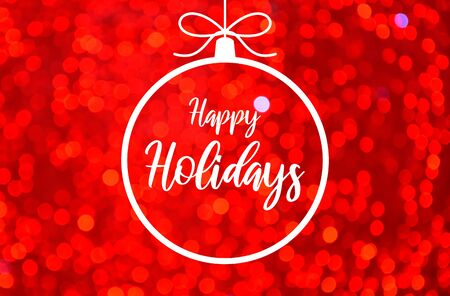 Happy Holidays sign with red blur effect. Glossy red background. Red blurred bokeh wallpaper. Festive blur backdrop. Christmas greeting card. Xmas bauble images