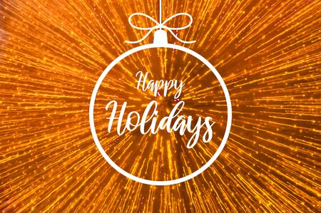Happy Holidays sign with radiant effect. Christmas greeting card. Festive blur backdrop. Christmas greeting card. Golden Christmas background. Xmas bauble images
