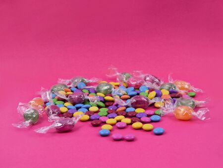 Colorful candies on pink background stock images. Sweets on pink background. Candy on white background with copy space for text