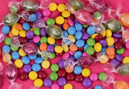 Colorful candies on pink background stock images. Sweets on pink background. Mix of candies. Colorful candies and sweets stock photography
