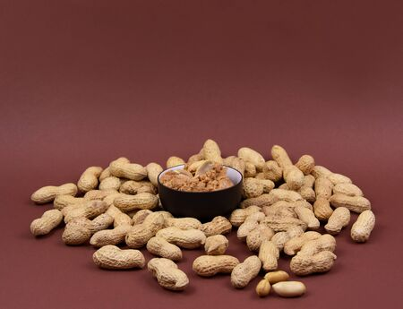 Peanut Butter stock photography Peanuts on brown background stock images. Pile of Peanuts with Nutshell. Roasted Peanuts on white background with copy space for text Imagens