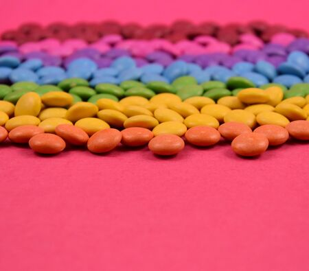 Colorful candies on pink background stock images. Sweets on a pink background. Colorful candies stock photography