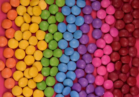 Colorful candies texture background stock photography. Stack of colorful candies. Rainbow colored candy coated chocolate pieces. Mix of candies Imagens