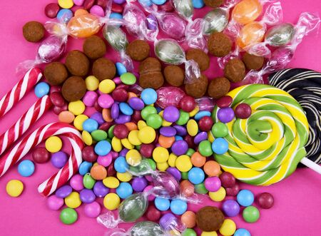 Colorful candies on pink background stock images. Sweets on pink background. Mix of candies. Colorful candies and sweets stock photography. Candies  lollipops images Imagens