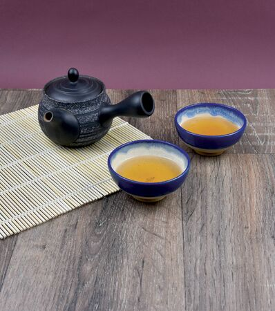 Traditional Chinese tea stock photography Ceramic tea set. Traditional Chinese tea set frame arrangement. Green tea on wooden background with copy space for text