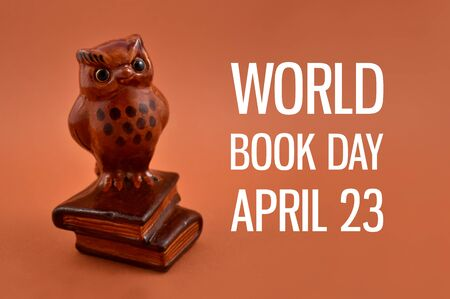 World Book Day with Wise Owl. Books with cute owl. Brown owl figurine. Book Day Poster, April 23 Stock Photo