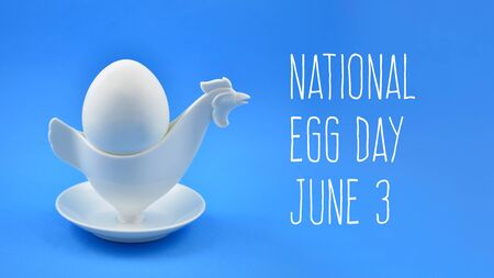 National Egg Day images. Chicken egg holder cup images. Boiled egg on a blue background. White plastic egg cup on a blue background. Breakfast still life. Egg Day Poster, June 3. Important day