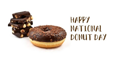 Happy Donut Day inscription with chocolate donut. National Donut Day Poster. Donut with chocolate icing on a white background. Donut with hazelnut chocolate stock images. American delicacy food