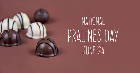 National Pralines Day. Chocolate pralines on a brown background stock images. Dark and white chocolate candies images. Pralines Day Poster, June 24. Important day 版權商用圖片