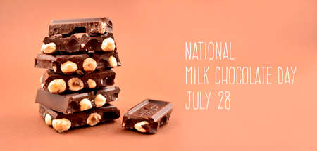 National Milk Chocolate Day stock images. Pile of Chocolate stock images. Nut chocolate on a brown background. Chocolate cubes on heap images. Milk Chocolate Day Poster, July 28. Important day