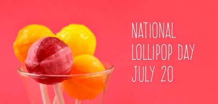 National Lollipop Day stock images. Colorful round lollipops on a pink background images. Pink and yellow lollipop images. Lollipop Day Poster, July 20