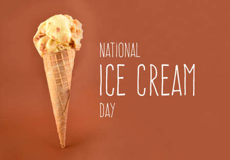 National Ice Cream Day stock images. Vanilla scoop ice cream stock images. Ice cream cone isolated on a brown background