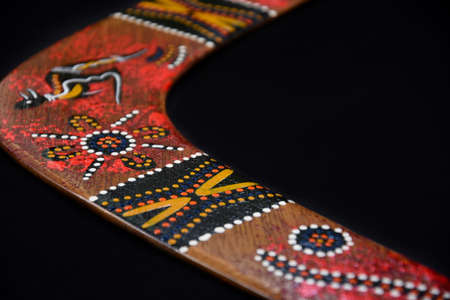 Australian hand painted boomerang detail stock images. Boomerang isolated on a black background with copy space for text. Boomerang frame stock images 写真素材