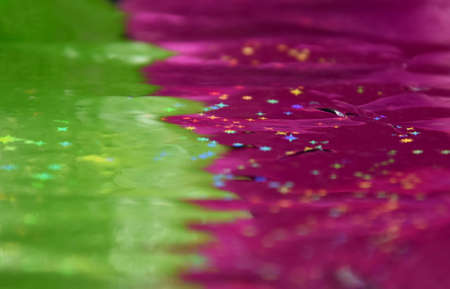 Abstract pink and green rich color background stock images. Pink and green vibrant background. Shiny colorful background with stars stock images