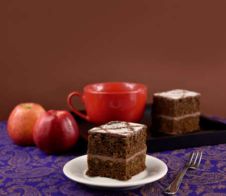 Apple chocolate cake brown frame stock images. Apple chocolate pie isolated on a brown background with copy space for text. Apple chocolate cake brown border. Cake with apples still life stock photo