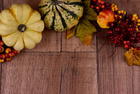 Autumn decoration on a wooden background frame stock images. Autumn decoration with pumpkins top view. Autumn season border stock images. Natural fall harvest background stock photo