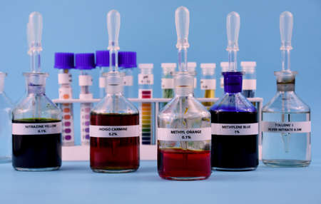 Color indicators of chemical change stock images. PH test color change images. Glass laboratory vials with color reagent stock photo. Laboratory accessories stock photo. Chemical still life photo