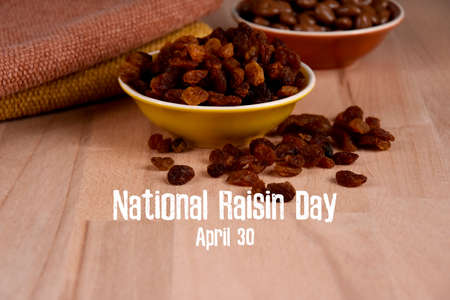 National Raisin Day stock images. Dried raisins in a bowl on a wooden background stock images. Raisins sultanas still life photo images. Raisin Day Poster, April 30. Important day