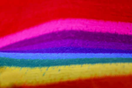 Rainbow cotton textile background stock images. Colorful fabric rainbow background stock photo. Multicolored bright background stock images. Abstract striped rainbow wallpaper Foto de archivo