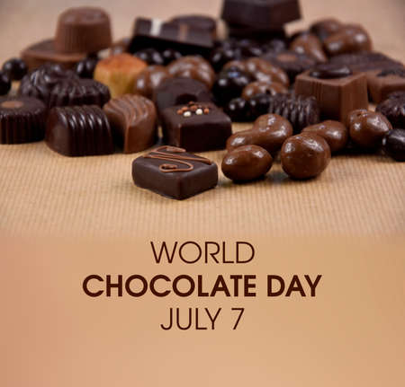 World Chocolate Day stock images. Different types of chocolate candies images. Chocolate pralines on a brown background stock photo. Chocolate Day Poster, July 7. Important day Imagens