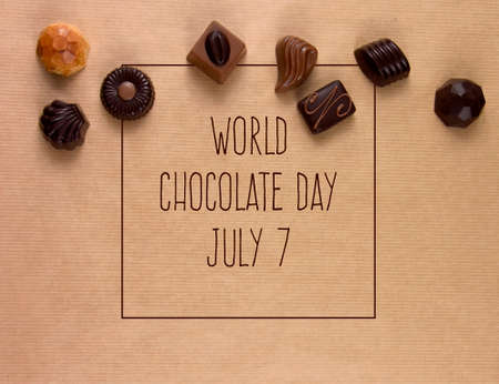 World Chocolate Day stock images. Different types of chocolate candies top view frame images. Chocolate pralines border stock photo. Chocolate Day Poster, July 7. Important day