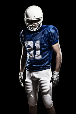 males only: Football Player with number on a blue uniform  Studio shot  Stock Photo