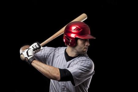 Baseball-Spieler auf einem schwarzen Hintergrund. Studioaufnahme. Standard-Bild - 19899844
