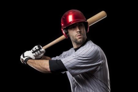 toughness: Baseball Player on a black background. Studio Shot.