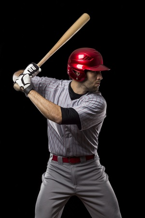 beisbol: Jugador de b�isbol sobre un fondo negro. Tiro del estudio.