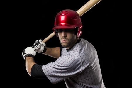 baseball bat: Baseball Player on a black background. Studio Shot.