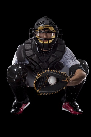 Baseball Player, catcher catching a ball, on a black background. Studio Shot. Standard-Bild