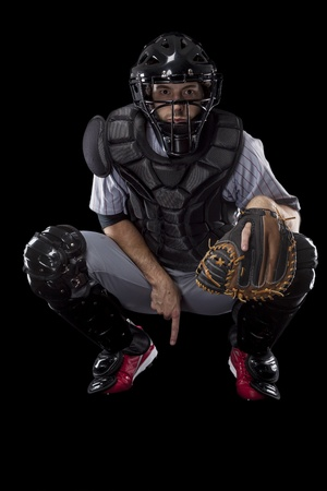 Baseball Player, catcher asking for a fast ball, on a black background. Studio Shot. photo