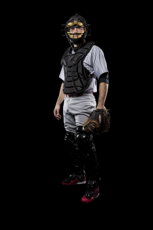 Baseball Player, catcher, on a black background. Studio Shot. photo
