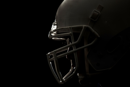 football helmet: Football Player with number on a blue uniform and a ball in the hand  Studio shot  Stock Photo