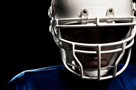 touchdown: Football Player with number on a blue uniform and a ball in the hand  Studio shot  Stock Photo