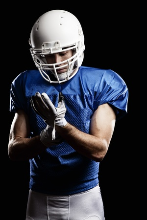 Football Player with number on a blue uniform. Studio shot. photo